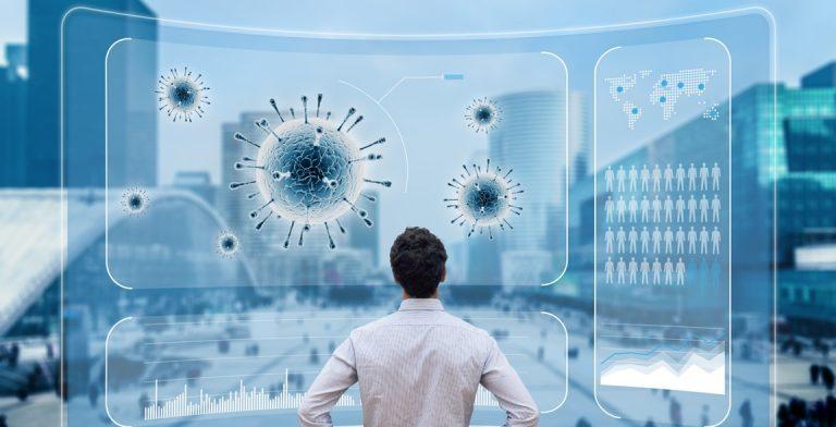 Corona Virus auf Screen mit Mann Förderungen Wien